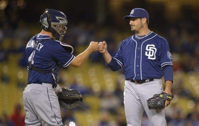 San Diego Padres starting pitcher Jason Marquis, right, is congratulated by catcher Nick Hundley as he is taken out of the game during the eighth inning of their baseball game against the Los Angeles Dodgers, Tuesday, April 16, 2013, in Los Angeles.  (AP Photo/Mark J. Terrill)