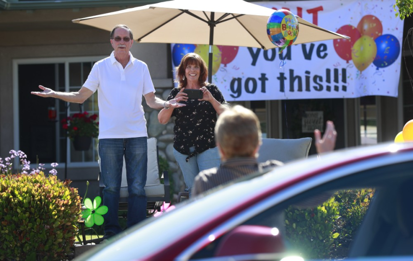 """Walt Ekard reacts to seeing former San Diego District Attorney Bonnie Dumanis during a drive-by """"get well soon"""" event at his Alpine home on May 24."""