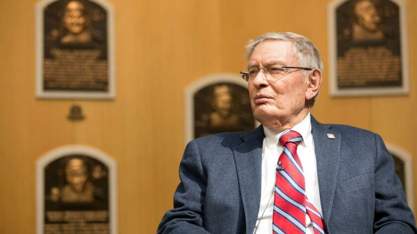 Former Major League Baseball Commissioner Bud Selig listens while touring the Hall of Fame during his orientation visit, on April 27 in Cooperstown.