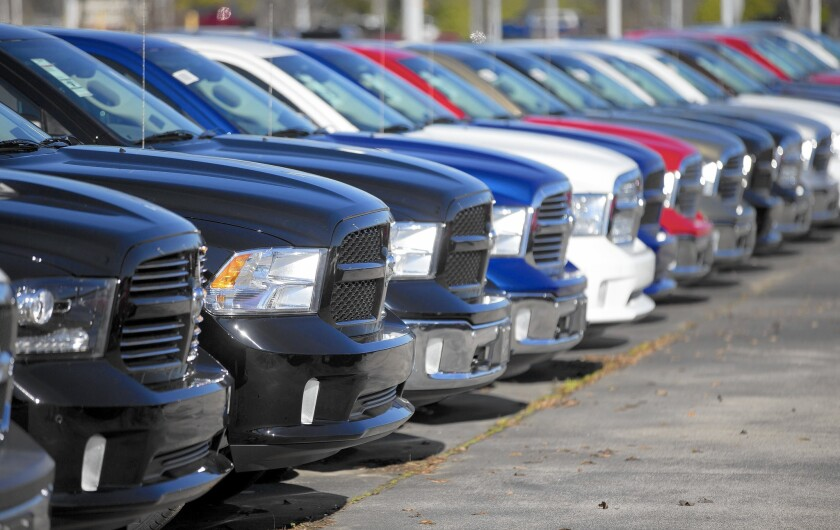 Dodge Ram pickup trucks are on display at a dealership in Morrow, Ga. December was one of the auto industry's best months of the year with sales of 1.5 million vehicles, 10.8% more than in the same month a year earlier.