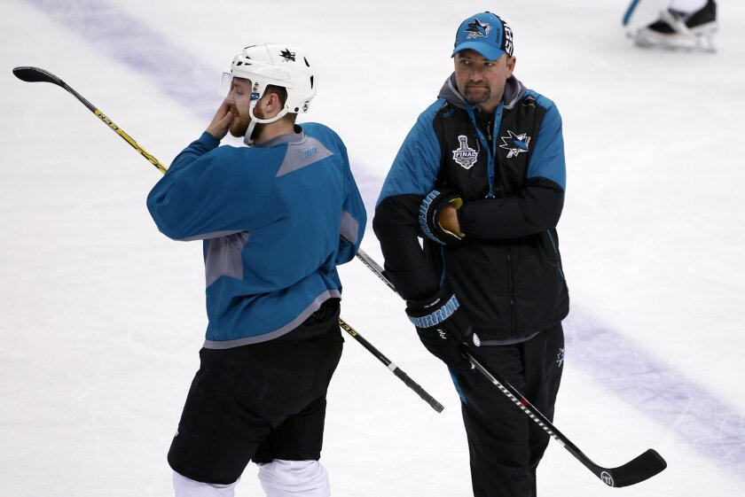 San Jose Sharks head coach Peter DeBoer, right, runs a hockey practice at the Consol Energy Center in Pittsburgh, Sunday May 29, 2016. The Sharks are preparing for Game 1 of the Stanley Cup Finals against the Pittsburgh Penguins on Monday, May 30, in Pittsburgh. (AP Photo/Gene J. Puskar)