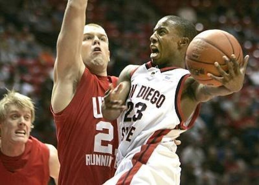 San Diego State's D.J. Gay, who scored 11 points, drives to the basket while being guarded by Utah's Shaun Green.