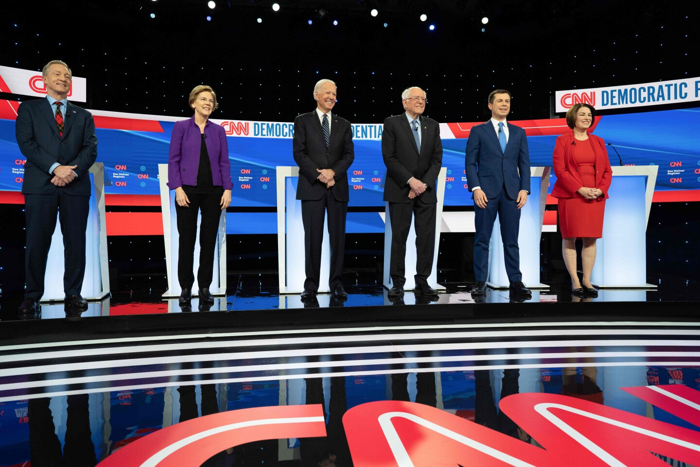 (L-R) Democratic presidential hopefuls billionaire-philanthropist Tom Steyer, Massachusetts Senator Elizabeth Warren, Former Vice President Joe Biden, Vermont Senator Bernie Sanders, Mayor of South Bend, Indiana, Pete Buttigieg and Minnesota Senator Amy Klobuchar stand on stage ahead of the seventh Democratic primary debate of the 2020 presidential campaign season co-hosted by CNN and the Des Moines Register at the Drake University campus in Des Moines, Iowa on January 14, 2020. (Photo by kerem yucel / AFP) (Photo by KEREM YUCEL/AFP via Getty Images) ** OUTS - ELSENT, FPG, CM - OUTS * NM, PH, VA if sourced by CT, LA or MoD **