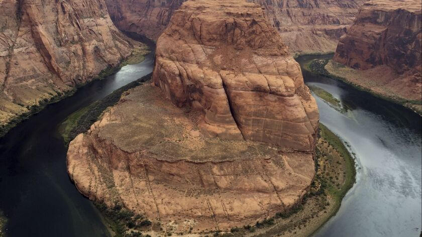 This Aug. 27, 2016, photo shows Horseshoe Bend near Page, Ariz. Authorities say a California girl vi