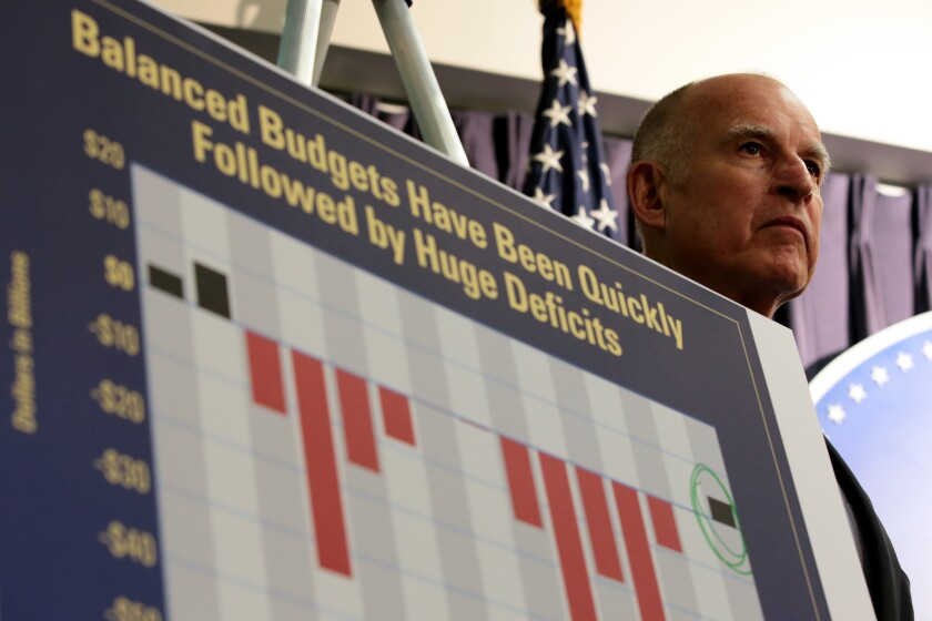 California Gov. Jerry Brown announces his proposed budget at a downtown Los Angeles news conference.