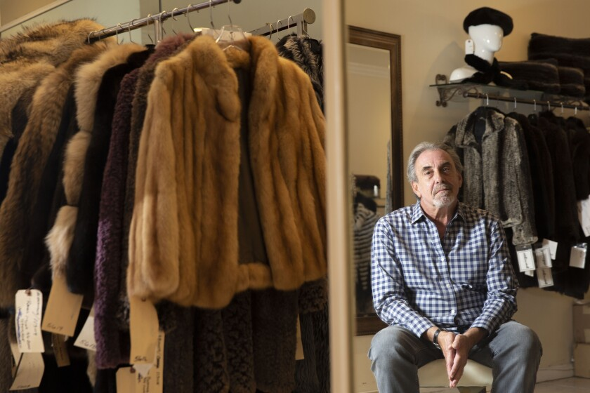 Larry Becker, owner of Dicker and Dicker of Beverly Hills, offers light, colorful furs that are popular despite the warm weather. He says a state ban on selling furs will put him out of business.