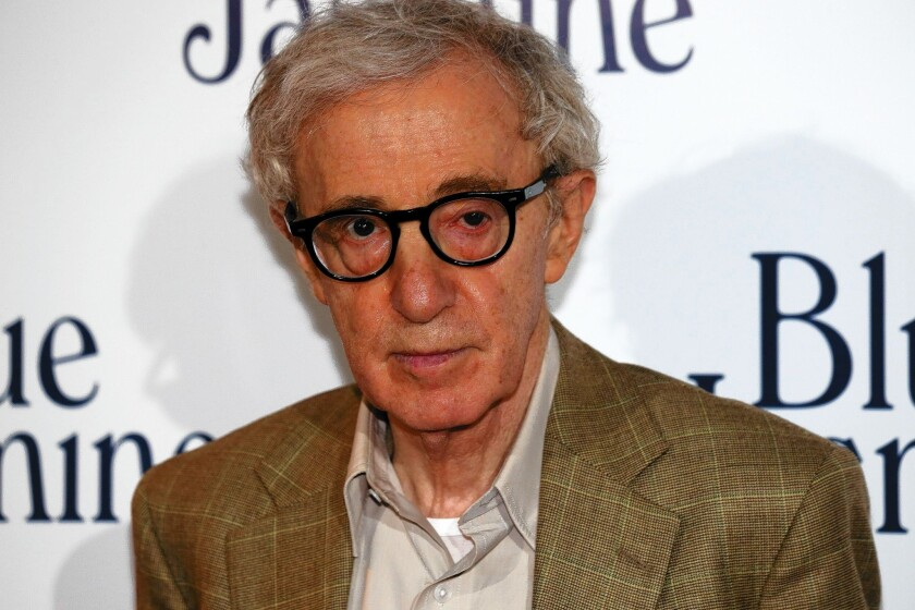 Woody Allen appears at a screening of his latest movie. His adopted daughter Dylan Farrow has written an open letter offering details about sexual abuse she says she suffered when she was 7.