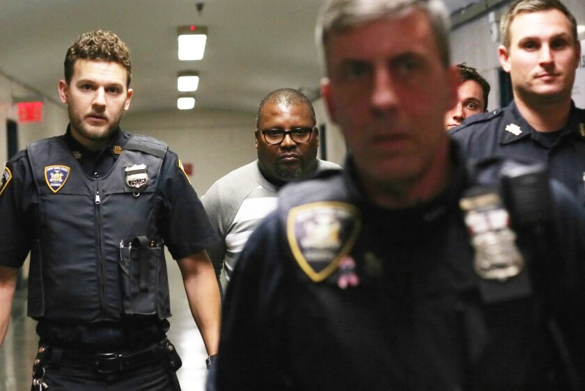 Dave Lewis is perp walked after being sentenced in Manhattan Criminal Court on October 25, 2018 in New York. Lewis received 30 days jail after being found guilty of failure to exercise due care when the Coach bus he was driving struck and killed a Citi Bike rider.