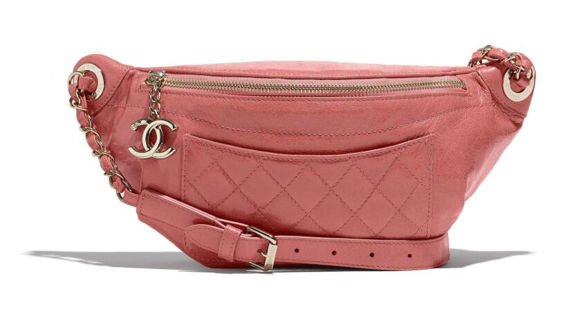 Chanel's pastel lambskin Waist Bag with shiny gold-tone metal hardware adds a pop of pastel to any s