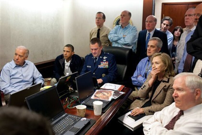 FILE - In this May 1, 2011 image released by the White House and digitally altered by the source to obscure the details of a document on the table, President Barack Obama, second from left, Vice President Joe Biden, left, Secretary of Defense Robert Gates, right, Secretary of State Hillary Rodham C