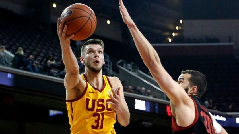 USC's Nick Rakocevic, shooting against Stanford's Josh Sharma this month, has much better stats at home than on the road.