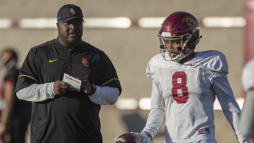Offensive coordinator Tee Martin, left, has been stripped of his play calling duties.
