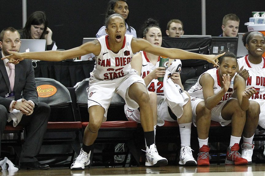 Gabrielle Clark (left) cheers for her teammates.