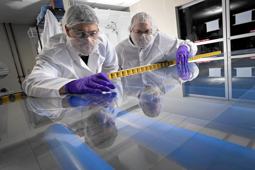 Technicians inspect Willow Glass at a Corning facility in New York state. The product is shipped in large rolls. Researchers around the world believe such glass can allow for flexible electronics: phones that can be folded in half, tablets that can be rolled up.