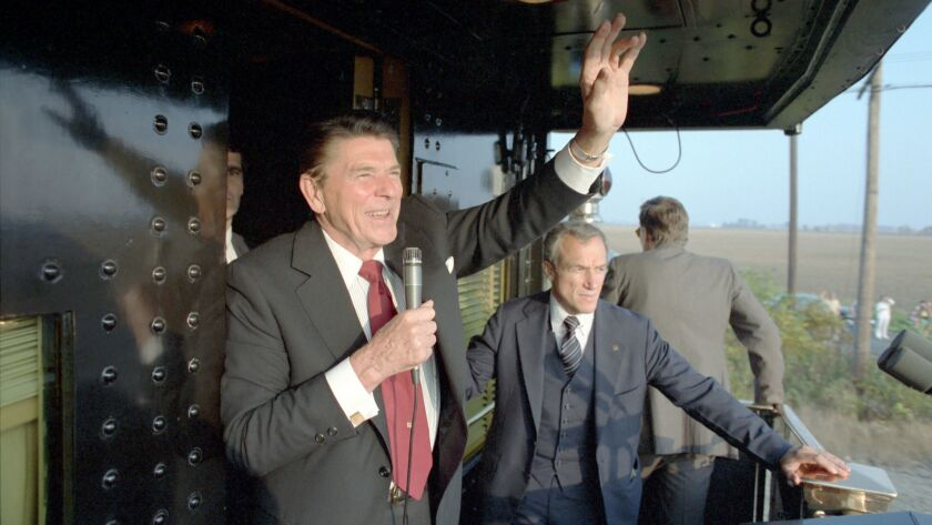 Secret Service agent Robert DeProspero, right, at President Reagan's side during a whistlestop tour through Ohio during his 1984 reelection campaign.