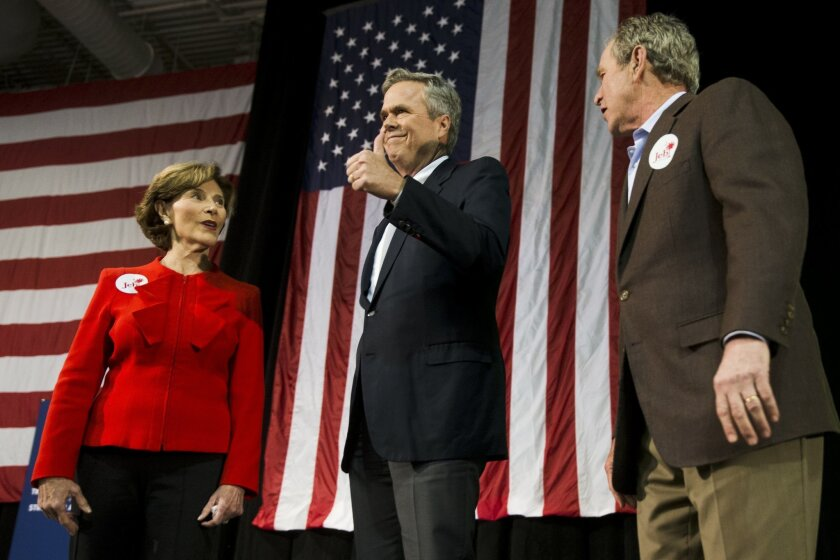 Republican presidential candidate and former Florida Gov. Jeb Bush, center, accompanied by his brother former President George W. Bush, right, and George's wife Laura Bush, takes the stage during a campaign stop Monday, Feb. 15, 2016, in North Charleston, S.C. (AP Photo/Matt Rourke)