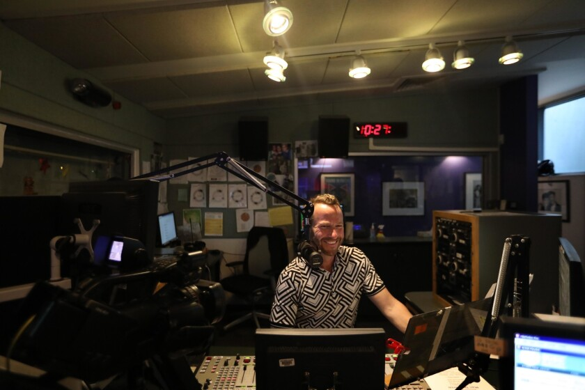 KCRW station manager Jennifer Ferro across campus at the station's new ten-years-in-the-making multi-media studios.