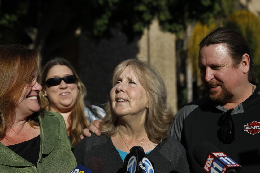 Susan Mellen speaks to the media last year as her attorney, Deirdre O'Connor, left, of Innocence Matters, Christy Kelly, second from left, and nephew, David Mellen, right, listen, after a judge determined she was factually innocent of a 1998 murder.