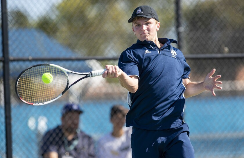 Newport Harbor's Josh Watkins returns a shot against Edison's Jason You during a Wave League match o
