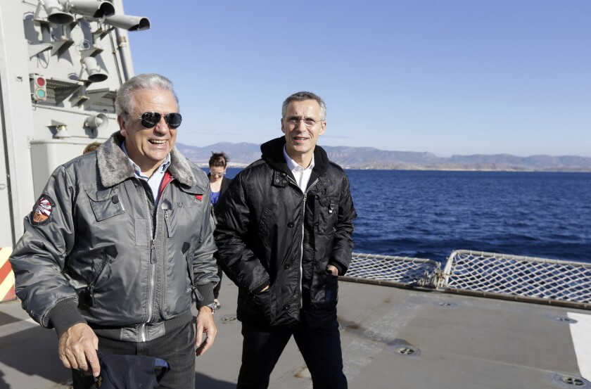 NATO Secretary-General Jens Stoltenberg, right, accompanied by Greece's Defense Minister Dimitris Avramopoulos aboard a Greek ship near Athens on Oct. 30. Stoltenberg was in Athens for talks that included renewed tension between Greece and Turkey over oil-and-gas exploration off the coast of divided Cyprus.