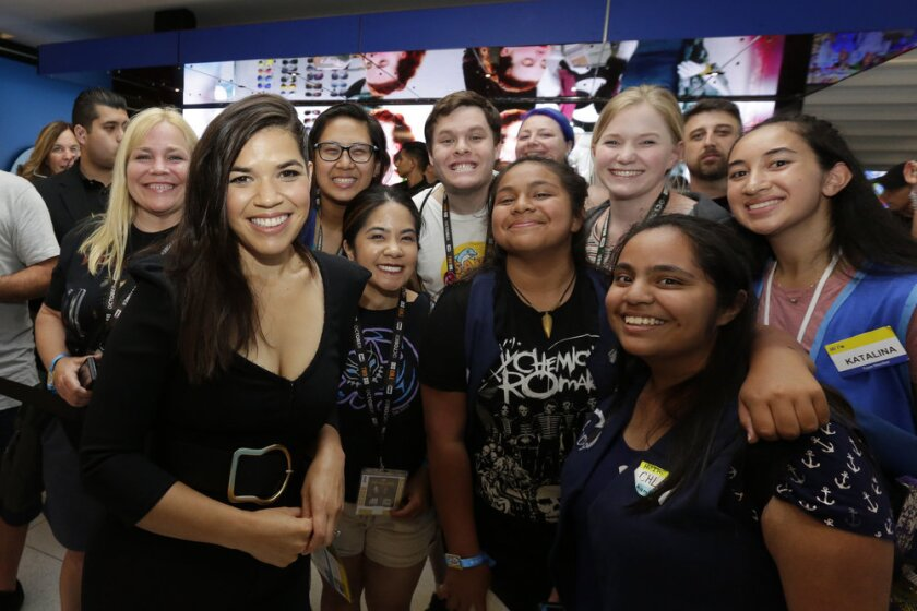 America Ferrera met blue-vested fans like Chloe Rodriguez (bottom right) at NBC's 'Superstore' activation at Comic-Con.