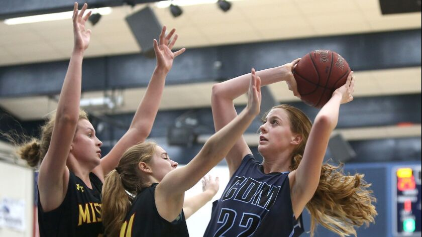 CDM's Tatiana Bruening pulls back for a two point jumper against two Mission Viejo defenders during