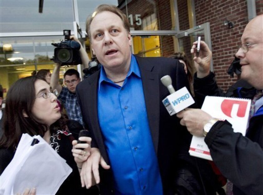 FILE - In this May 21, 2012 file photo, former Boston Red Sox pitcher Curt Schilling, center, departs the Rhode Island Economic Development Corporation headquarters in Providence, R.I. Attorneys representing Schilling and others at his former startup, 38 Studios, on Friday, March 1, 2013, filed documents asking Superior Court Judge Michael Silverstein to dismiss a state economic development agency lawsuit over its $75 million loan guarantee for his now-defunct video game company. (AP Photo/Stev