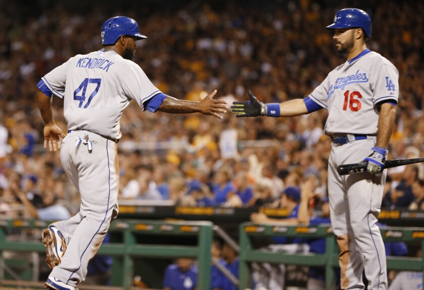 Dodgers second baseman Howie Kendrick (47) is greeted by teammate Andre Ethier after scoring on a hit by Adrian Gonzalez in the third inning Sunday in Pittsburgh.