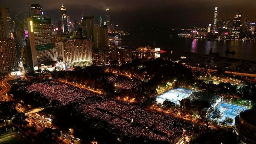Thousands of people attend a candlelight vigil in Hong Kong for victims of the Chinese government's lethal 1989 crackdown on protesters in Beijing's Tiananmen Square.