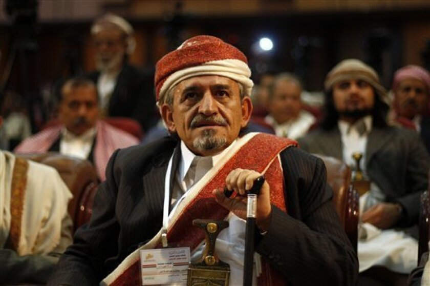 Sheikh Sadeq al-Ahmar, the head of Yemen's powerful Hashid tribe, attends a first meeting by Yemeni tribal coalition to discuss their role in a national dialogue which is set to be held in November, to address political, security and economic challenges the country faces in Sanaa, Yemen, Saturday, Oct. 6, 2012. (AP Photo/Hani Mohammed)