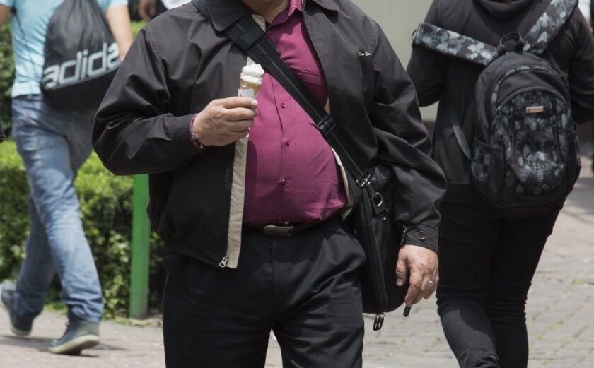 Being overweight or obese led to nearly half a million cases of cancer in 2012, a new study finds.