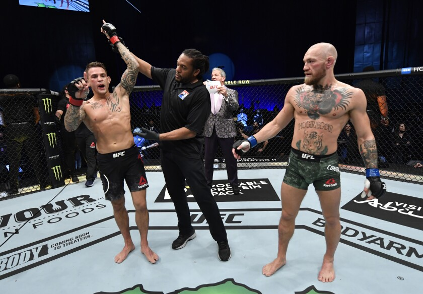 Dustin Poirier celebrates as his arm is lifted following a knockout of Conor McGregor in January.