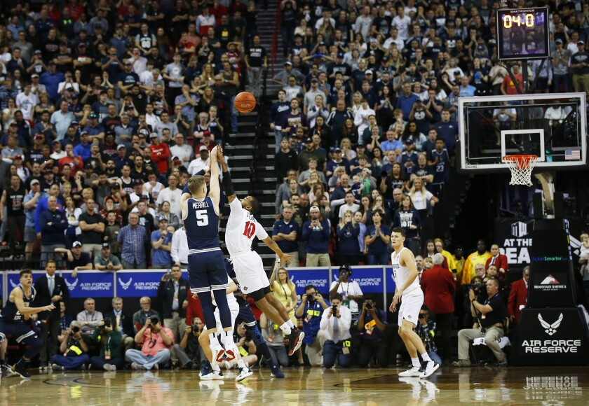 Utah State's Sam Merrill makes a game-winning 3 over San Diego State's KJ Feagin.