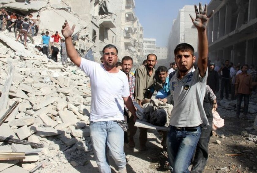 Syrians evacuate a victim following an airstrike by government forces in the northern city of Aleppo.