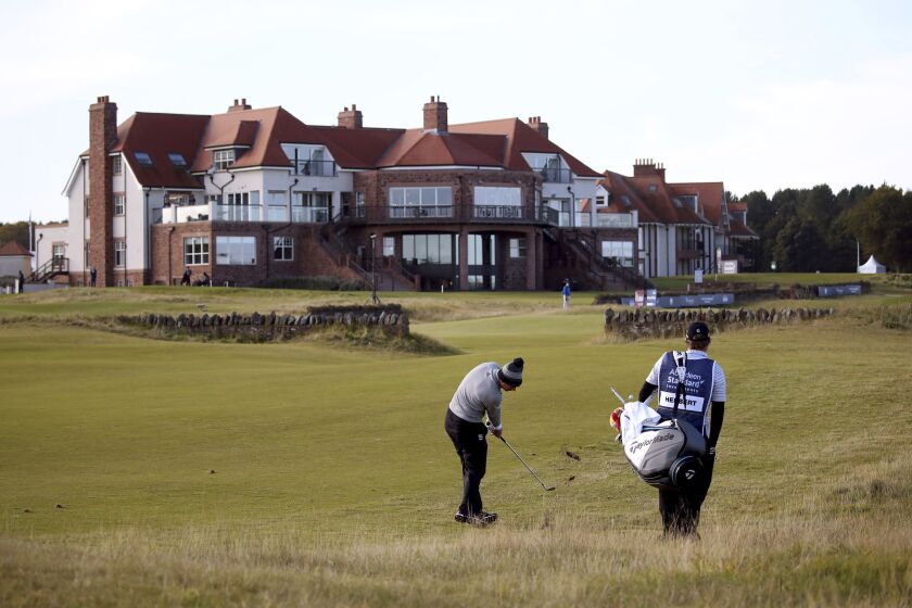 Australia's Lucas Herbert plays down the eighteenth during the second round of the Scottish Open at The Renaissance Club, North Berwick, Scotland, Friday, Oct. 2, 2020. (Jane Barlow/PA via AP)