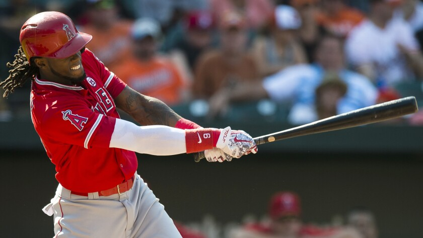 Angels pinch-hitter Cameron Maybin connects for a run-scoring single that drove in what proved to be