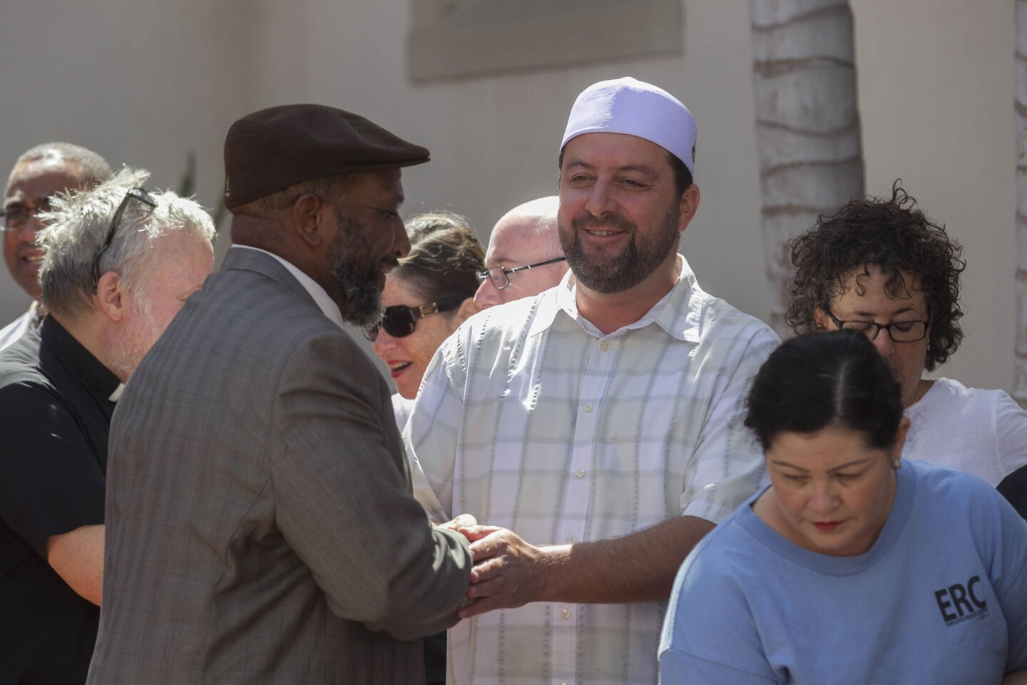 Imam Taha Hassane, right, of the Islamic Center of San Diego, greeted Bishop Cornelius Bowser, left, of the Charity Apostolic Church.