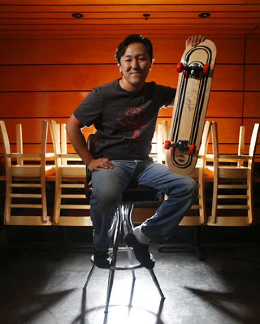 NOT FOR RIDING: Sang Yoon, owner and chef of Father's Office, brings out his prize board signed by skater Tony Hawk.