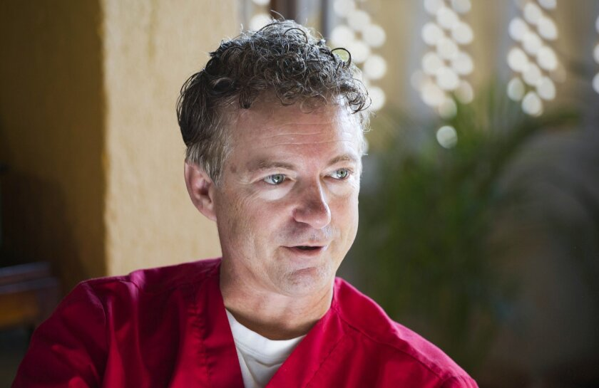 In this Aug. 17, 2015 photo, Republican presidential candidate Sen. Rand Paul, R-Ky. speaks during an interview before participating in a cataract surgery clinic in Cap-Haitien, Haiti. An ophthalmologist by training, Paul left Haiti on Wednesday afternoon after spending four days on a humanitarian mission to the island nation. (AP Photo/Dieu Nalio Chery)