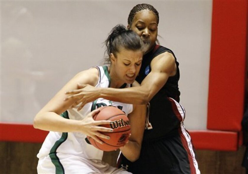 Notre Dame forward Becca Bruszewski (32), left, has the ball stripped away by Temple guard Shey Peddy (11) during the first half of their second-round game of the NCAA women's college basketball tournament Monday, March 21, 2011, in Salt Lake City. (AP Photo/Jim Urquhart)