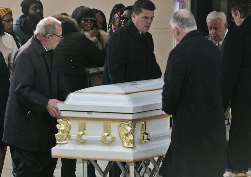 Family members mourn as pallbearers carry the coffin for Rebecca Cutler following those of  her daughters Ziana and Maiyah, as they leave Brooklyn Funeral Home, Friday, Feb. 19, 2016, in New York. Cutler's boyfriend Michael Sykes, also Maiyah's father, has been arrested and charged with the stabbin