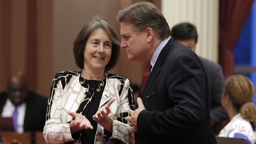 Democratic state Sens. Nancy Skinner of Berkeley and Bob Hertzberg of Van Nuys talk at the Capitol. Hertzberg's SB 10 ends money bail for suspects awaiting trial. Skinner's SB 1437 narrows the state's felony murder rule. Both bills were signed by Gov. Brown.