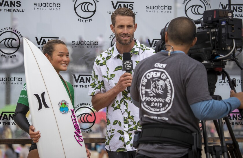 World Surf League broadcast commentator Ian Foulke, center, interviews surfer Meah Collins.