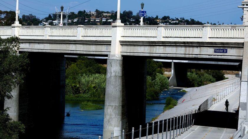 A bike path runs alongside the Los Angeles River in Elysian Valley.