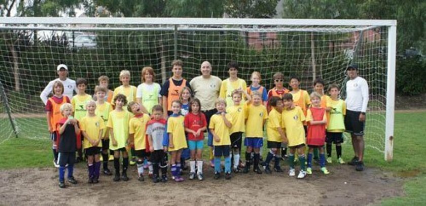 Borussia Del Mar founder Tommy Maurer, center, with children at one of his soccer camps.