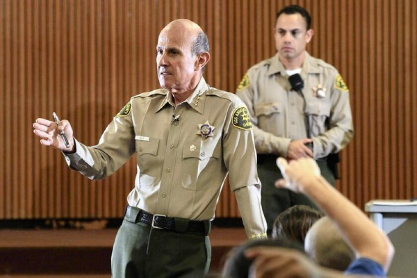 Los Angeles County Sheriff Lee Baca meets with inmates to listen to their complaints at Men's Central Jail in Los Angeles. He said he would return to Men's Central Jail next Saturday to continue the dialogue, and would hold similar gatherings in other county jails.