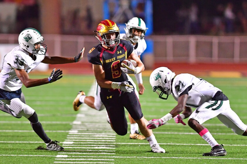 TPHS junior Mac Bingham rished for two touchdowns, including a 44-yard run, in the Falcons game against Oceanside. The Falcons won the game with a score of 30-0.