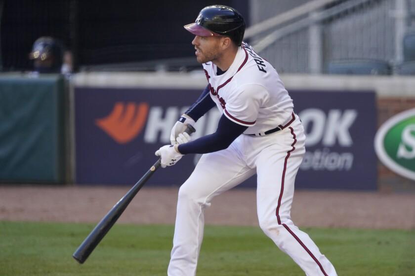 Atlanta Braves' Freddie Freeman follows through on his game-winning base hit against the Cincinnati Reds.