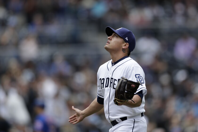 Padres reliever Gerardo Reyes reacts after striking out the Mets' Todd Frazier last month.
