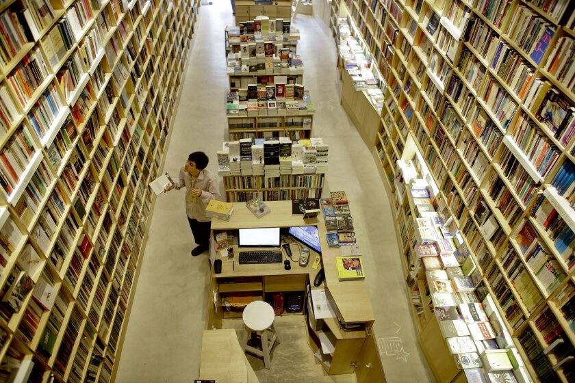 FILE - In this Tuesday, April 21, 2015, file photo, an employee works at a bookstore in Buenos Aires, Argentina. Buenos Aires is the city with more book shops per capita of any capital city in the world, according to a recent study released by the World Cities Culture Forum, a collaborative network